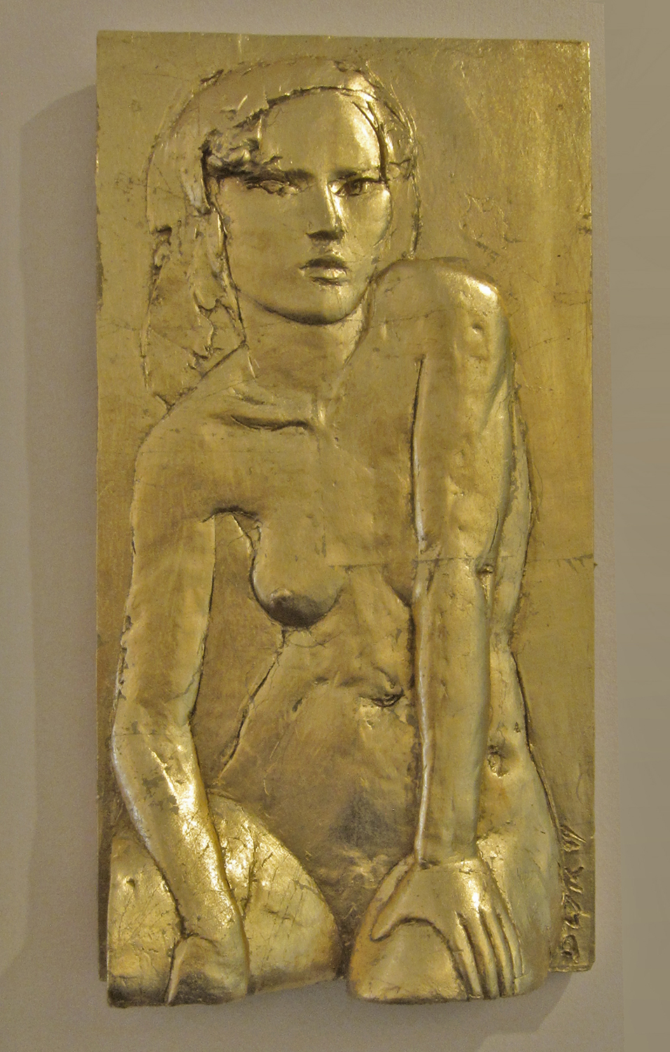 Seated Figure With Gold relief sculpture